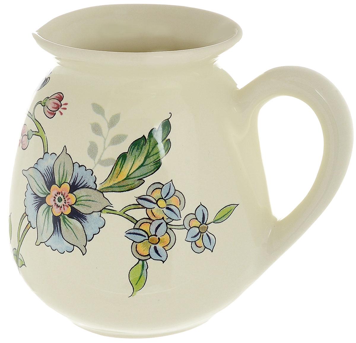 Молочник Nuova Cer Прованс, 350 млPRV-7361Молочник Nuova Cer Провансвыполнен из высококачественной керамики. Изделие станет незаменимым аксессуаром для тех, кто любит пить кофе или чай с добавлением молока. Дизайн молочника придется по вкусу и ценителям классики, и тем, кто предпочитает утонченность и изысканность. Также молочник послужит приятным и практичным подарком. Изделие нельзя мыть в посудомоечной машине. Диаметр молочника по верхнему краю: 7 см. Высота молочника: 11 см.