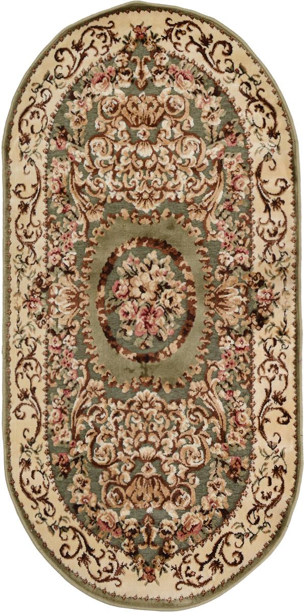 Ковер Mutas Carpet Silk Road, овальный, цвет: зеленый, бежевый, коричневый, 80 х 150 смUP210DFКовер Mutas Carpet Silk Road изготовлен из прочного полипропилена. Полипропилен износостоек, нетоксичен, не впитывает влагу, не провоцирует аллергию. Структура волокна в полипропиленовых коврах гладкая, поэтому грязь не будет въедаться и скапливаться на ворсе. Практичный и износоустойчивый ворс не истирается и не накапливает статическое электричество. Ковер обладает хорошими показателями теплостойкости и шумоизоляции. Оригинальный рисунок позволит гармонично оформить интерьер комнаты, гостиной или прихожей. За счет невысокого ворса ковер легко чистить. При надлежащем уходе синтетический ковер прослужит долго, не утратив ни яркости узора, ни блеска ворса, ни упругости. Самый простой способ избавить изделие от грязи - пропылесосить его с обеих сторон (лицевой и изнаночной). Влажная уборка с применением шампуней и моющих средств не противопоказана. Хранить рекомендуется в свернутом рулоном виде.