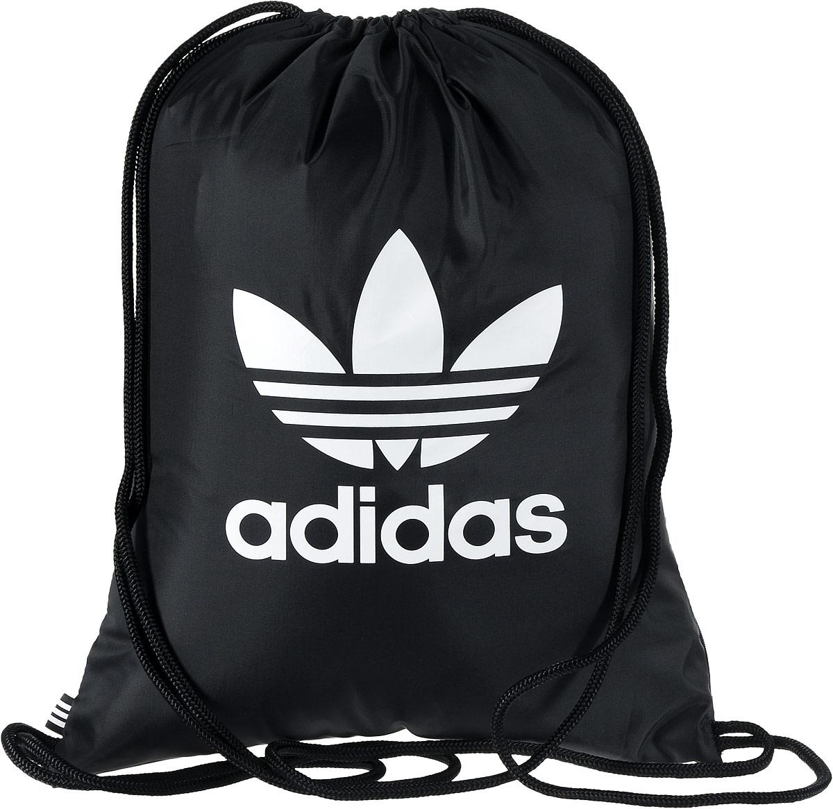 Рюкзак спортивный Adidas Trefoil, цвет: черный, 23 л. BK672600052653Стильный спортивный рюкзак Adidas Trefoil выполнен из полиэстера и оформлен символикой бренда. Изделие имеет одно основное отделение, которое закрывается с помощью затягивающего шнурка.С внутренней стороны изделие оснащено удобной ручкой для переноски. Снаружи, с одной из боковых сторон находится прорезной карман на застежке-молнии. Веревочные завязки можно использовать как наплечные лямки. Стильный и функциональный рюкзак поместит все необходимое.
