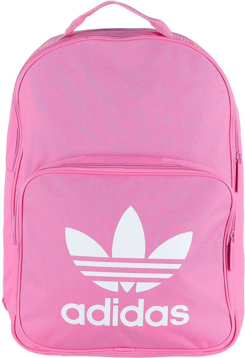 Рюкзак спортивный Adidas Trefoil, цвет: розовый, 23 лBK6725Спортивный рюкзак Adidas Trefoil выполнен из полиэстера. Изделие имеет одно отделение, которое застегивается на застежку-молнию. Внутри находится вместительный накладной карман для ноутбука. Снаружи, на передней стенке расположен накладной карман на застежке-молнии, оформленный фирменным логотипом и названием бренда. Рюкзак оснащен широкими регулируемыми лямками и ручкой для переноски в руке.