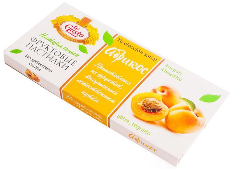 te Gusto Фруктовые пастилки из абрикоса, 40 г4657155301474Фруктовые пастилки te Gusto без ГМО, глютена, сои, сахара, фруктозы, красителей, усилителей вкуса, загустителей. В составе только один ингредиент – плод, выращенный в экологически чистом районе. Пастилки изготовлены методом солнечной сушки, без консервантов. Абрикос улучшает память, повышает мозговую активность, придаёт силу и бодрость. Особый способ измельчения плодов позволяет сохранить витамины в первозданном виде. Данный продукт создан для людей, ведущих здоровый образ жизни и уделяющих большое внимание своему питанию. Для спортсменов это полезный и питательный перекус, для вегетарианцев – сладость, не содержащая продуктов животного происхождения, для детей – натуральное лакомство, которое единожды попробовав, они предпочитают шоколадкам, и для всех, вне зависимости от возраста и систем питания – здоровый продукт без красителей, консервантов и подсластителей.