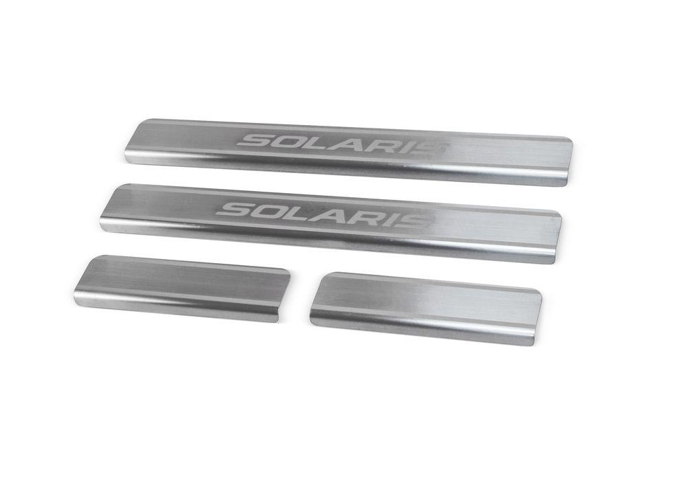 """Накладки на пороги Rival для Hyundai Solaris 2011-, 4 штNP.2301.3Накладки на пороги RIVAL Накладки на пороги создают индивидуальный интерьер автомобиля и защищают лакокрасочное покрытие от механических повреждений - Использование высококачественной итальянской нержавеющей стали AISI 304. - Надежная фиксация на автомобиле с помощью """"фирменного"""" скотча 3М. - Устойчивое к истиранию изображение на накладках нанесено методом абразивной полировки. - Идеально повторяют геометрию порогов автомобиля. Уважаемые клиенты! Обращаем ваше внимание, что накладки имеют форму и комплектацию, соответствующую модели данного автомобиля. Фото служит для визуального восприятия товара."""