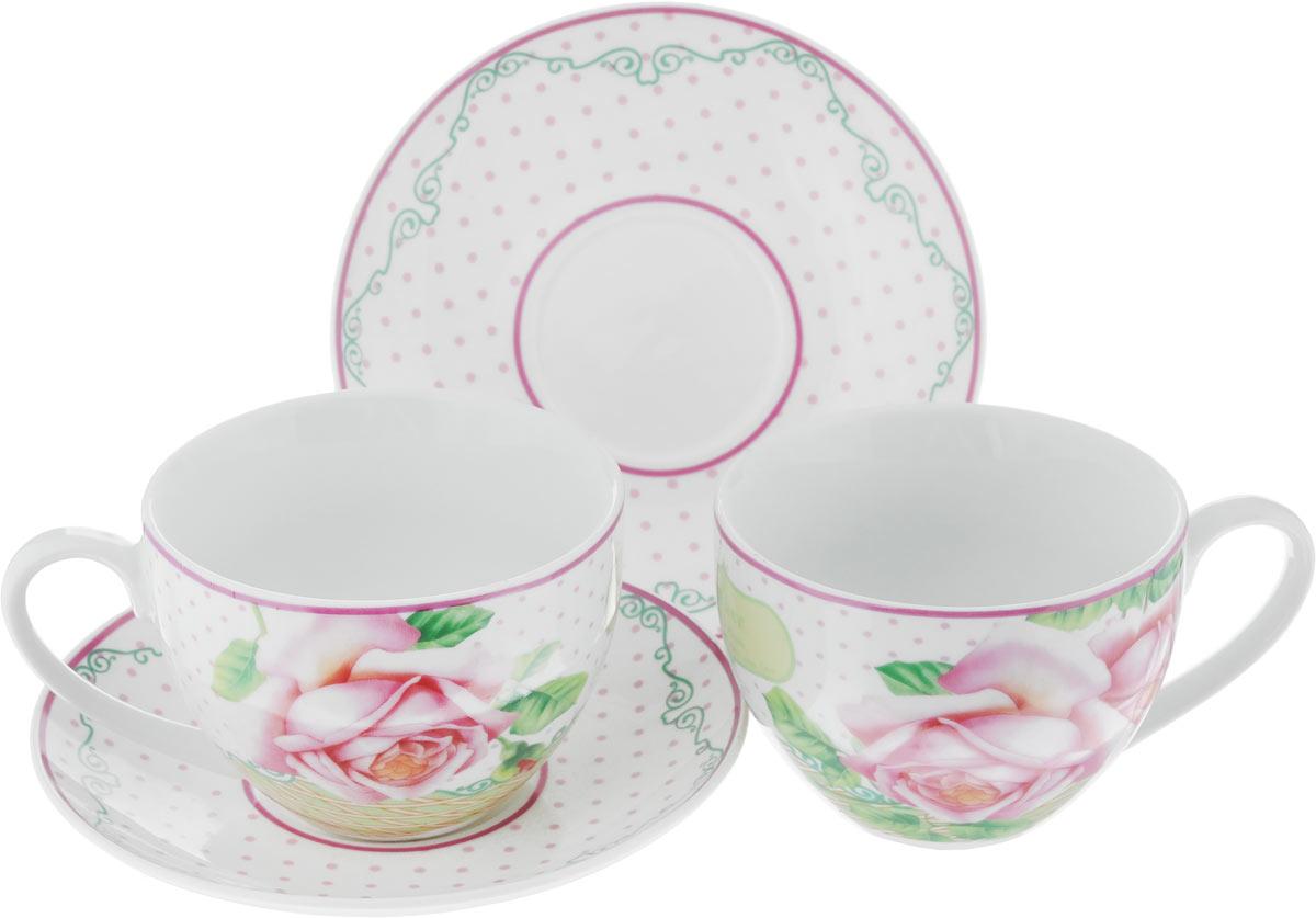 Набор чайный Loraine Розы, цвет: розовый, зеленый, 4 предмета22999Чайный набор Loraine Розы, выполненный из керамики, состоит из 2 чашек и 2 блюдец. Предметы набора имеют яркую расцветку. Изящный дизайн и красочность оформления придутся по вкусу и ценителям классики, и тем, кто предпочитает современный стиль. Чайный набор - идеальный и необходимый подарок для вашего дома и для ваших друзей в праздники, юбилеи и торжества! Он также станет отличным корпоративным подарком и украшением любой кухни. Чайный набор упакован в подарочную коробку из плотного цветного картона. Внутренняя часть коробки задрапирована белым атласом. Диаметр кружки (по верхнему краю): 9 см. Высота стенки: 6,5 см. Диаметр блюдца: 14 см. Высота блюдца: 2 см. Объем чашки: 220 см.