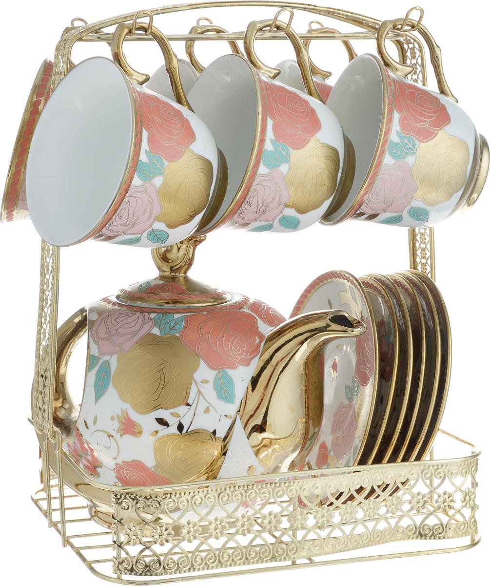 Набор чайный Loraine, на подставке, 14 предметов. 2478424784Чайный набор Loraine состоит из 6 чашек, 6 блюдец, заварочного чайника и подставки. Посуда изготовлена из качественной глазурованной керамики и оформлена изображением цветов. Все предметы располагаются на удобной металлической подставке с ручкой. Подставка имеет сборную конструкцию (при необходимости ручку можно снять). Элегантный дизайн набора придется по вкусу и ценителям классики, и тем, кто предпочитает современный стиль. Он настроит на позитивный лад и подарит хорошее настроение с самого утра. Чайный набор Loraine идеально подойдет для сервировки стола и станет отличным подарком к любому празднику. Можно использовать в СВЧ и мыть в посудомоечной машине. Объем чашки: 250 мл (при наполнении до края). Диаметр чашки (по верхнему краю): 9 см. Высота чашки: 7 см. Диаметр блюдца: 13,2 см. Высота блюдца: 1,5 см. Объем чайника: 950 мл. Размер чайника: 21 х 10 х 11,5 см. Размер подставки: 22,5 х 18 х...