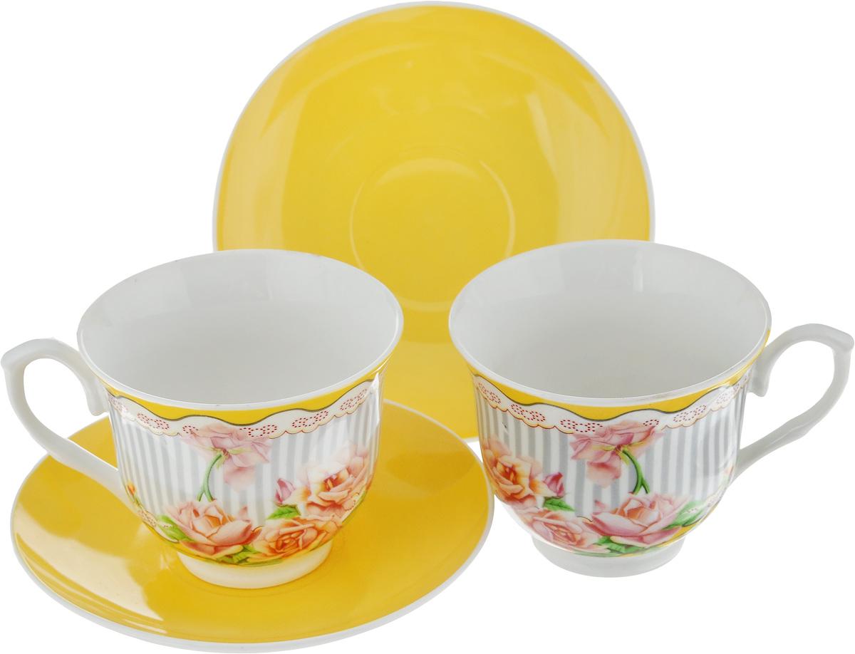 Набор чайный Loraine Чайная роза, 4 предмета. 2300723007Чайный набор Loraine состоит из двух чашек и двух блюдец. Изделия выполнены из высококачественного костяного фарфора, чашки оформлены красивым цветочным рисунком, а блюдца однотонные. Такой набор красиво дополнит сервировку стола к чаепитию. Благодаря изысканному дизайну и качеству исполнения, такой набор станет замечательным подарком для ваших друзей и близких. Набор упакован в подарочную коробку, задрапированную белой атласной тканью. Объем чашки: 220 мл. Диаметр чашки (по верхнему краю): 9 см. Высота чашки: 7,5 см. Диаметр блюдца: 14 см.