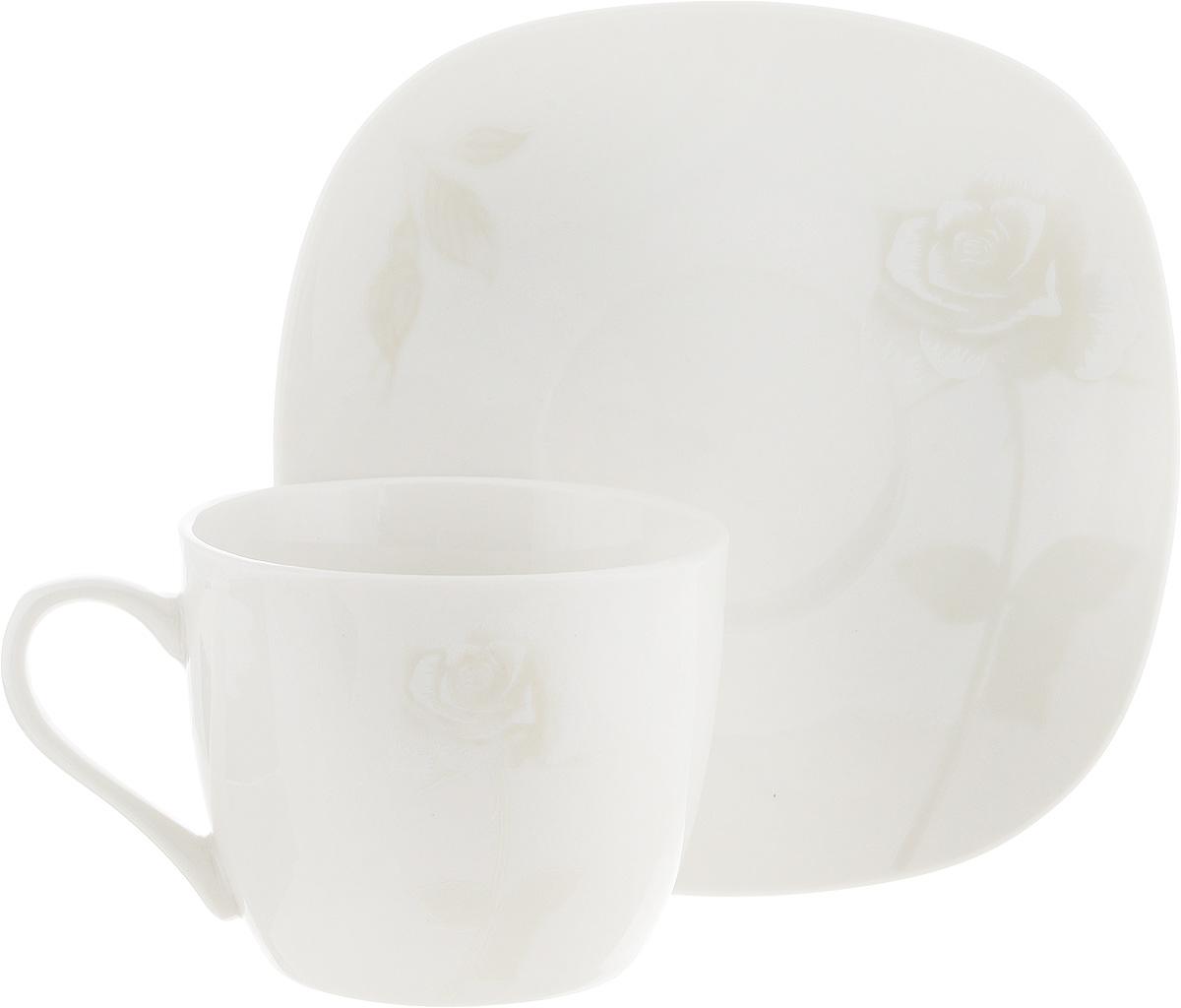 Чайная пара Жемчужная роза, цвет: молочный, 2 предмета216694Чайная пара Жемчужная роза состоит из чашки и блюдца, изготовленных из высококачественной керамики. Красочность оформления придется по вкусу ценителям утонченности и изысканности. Диаметр чашки по верхнему краю: 8 см. Высота чашки: 7 см. Объем чашки: 220 мл. Размер блюдца: 15 см х 15 см.
