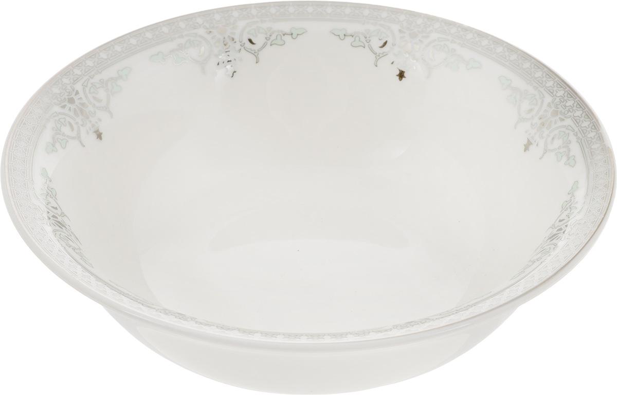 Салатник Венеция, диаметр 16 см216688Элегантный салатник Венеция, изготовленный из высококачественного фарфора с глазурованным покрытием, прекрасно подойдет для подачи различных блюд: закусок, салатов или фруктов. Такой салатник украсит ваш праздничный или обеденный стол, а оригинальное исполнение понравится любой хозяйке. Диаметр салатника (по верхнему краю): 15 см. Высота салатника: 5 см.