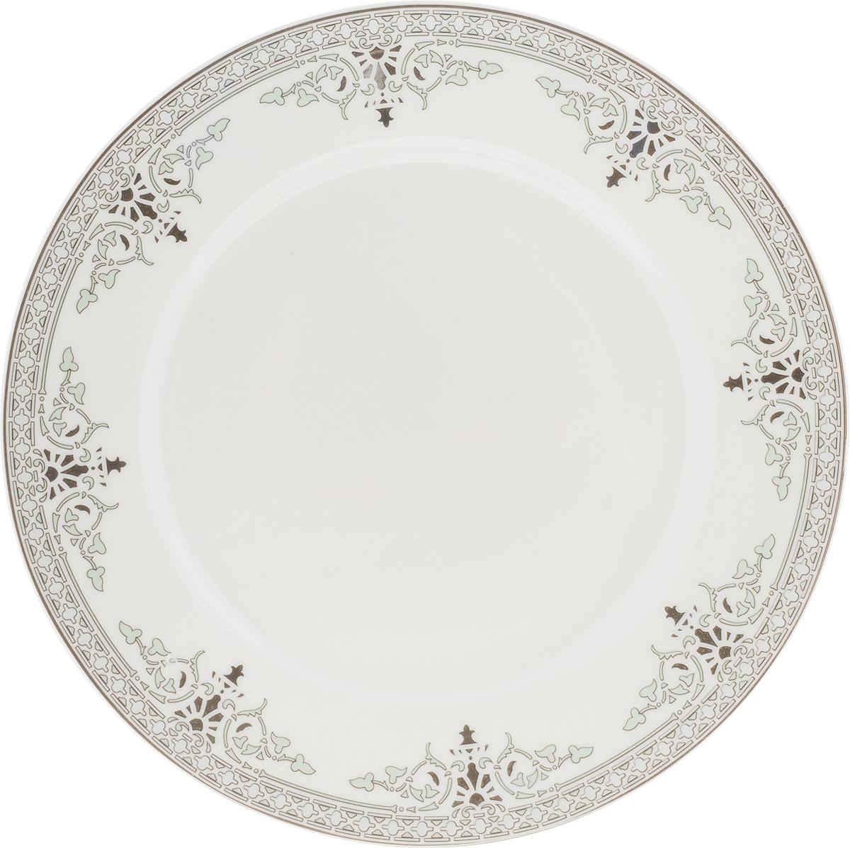 Тарелка десертная Венеция, диаметр 19 см216685Десертная тарелка Венеция изготовлена из глазурованного фарфора. Она предназначена для подачи десертов. Также может использоваться как блюдо для сервировки закусок. Изящная тарелка прекрасно оформит стол и порадует ваших гостей изысканным дизайном и формой. Диаметр тарелки: 19 см.