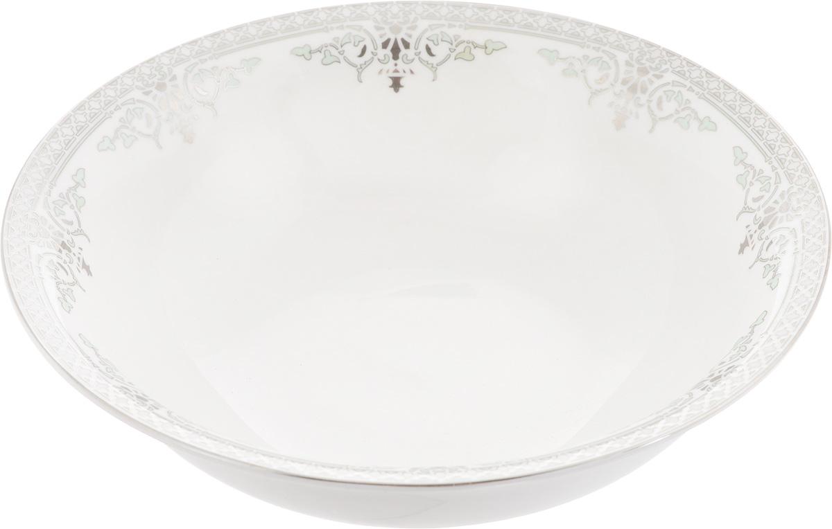 Салатник Венеция, диаметр 23 см216689Элегантный салатник Венеция, изготовленный из высококачественного фарфора с глазурованным покрытием, прекрасно подойдет для подачи различных блюд: закусок, салатов или фруктов. Такой салатник украсит ваш праздничный или обеденный стол, а оригинальное исполнение понравится любой хозяйке. Диаметр салатника (по верхнему краю): 23 см. Высота салатника: 7 см.