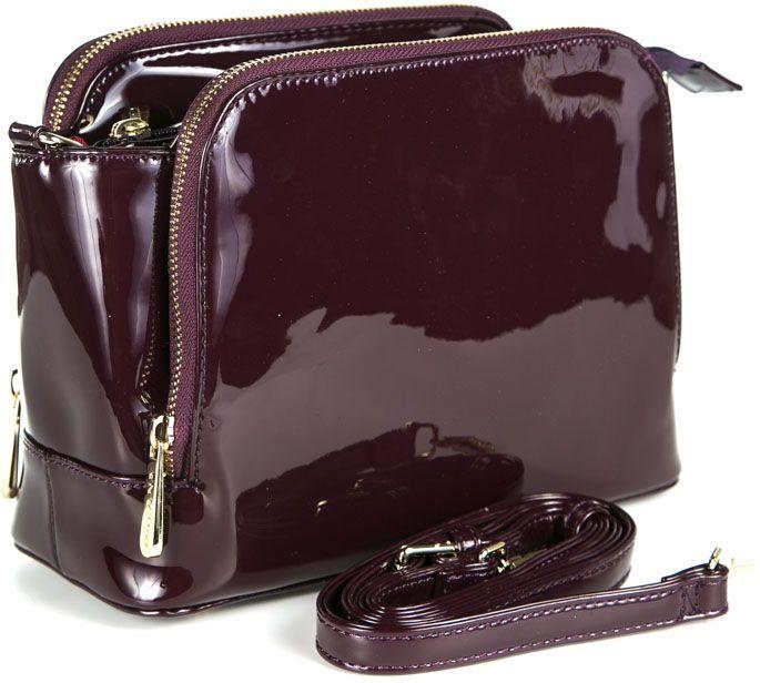 Сумка женская Milana, цвет: бордовый. 162656-1-751162656-1-751Удобная женская сумка Milana изготовлена из искусственной кожи. Внутренняя подкладка выполнена из искусственного шелка. Сумка закрывается на застежку молнию. Внутри имеется одно основное отделение, которое оснащено одним втачным карманом на молнии и двумя накладными открытыми кармашками. Внешняя сторона сумки дополнена двумя боковыми карманами на молниях. Модель оснащена съемным плечевым ремешком. Оригинальный аксессуар позволит вам завершить образ и быть неотразимой.