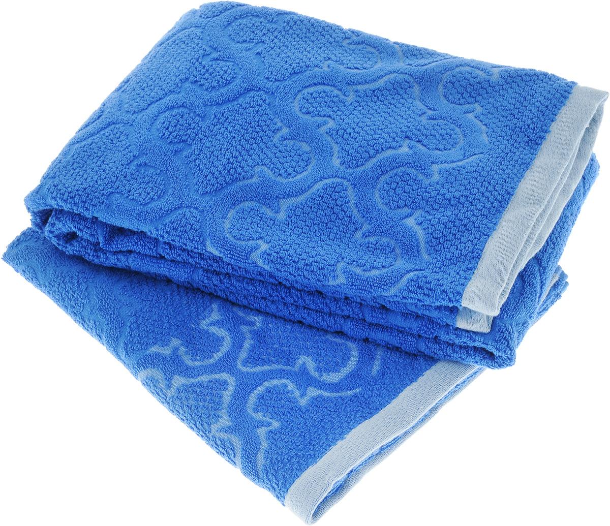 Набор махровых полотенец Toalla Лагуна, цвет: синий, 2 шт92717301Набор Toalla Лагуна состоит из 2 прямоугольных махровых полотенец, выполненных из 100% хлопка. Ткань полотенец обладает высокой плотностью и мягкостью, отличается высоким качеством и длительным сроком службы. В процессе эксплуатации материал становится только мягче и приятней на ощупь. Египетский хлопок не содержит линта (хлопковый пух), поэтому на ткани не образуются катышки даже после многократных стирок и длительного использования. Сверхдлинные волокна придают ткани характерный красивый блеск. Полотенца отлично впитывают влагу и быстро сохнут. Такой набор красиво дополнит интерьер ванной комнаты и станет практичным приобретением. Полотенца оформлены изысканным рельефным орнаментом.