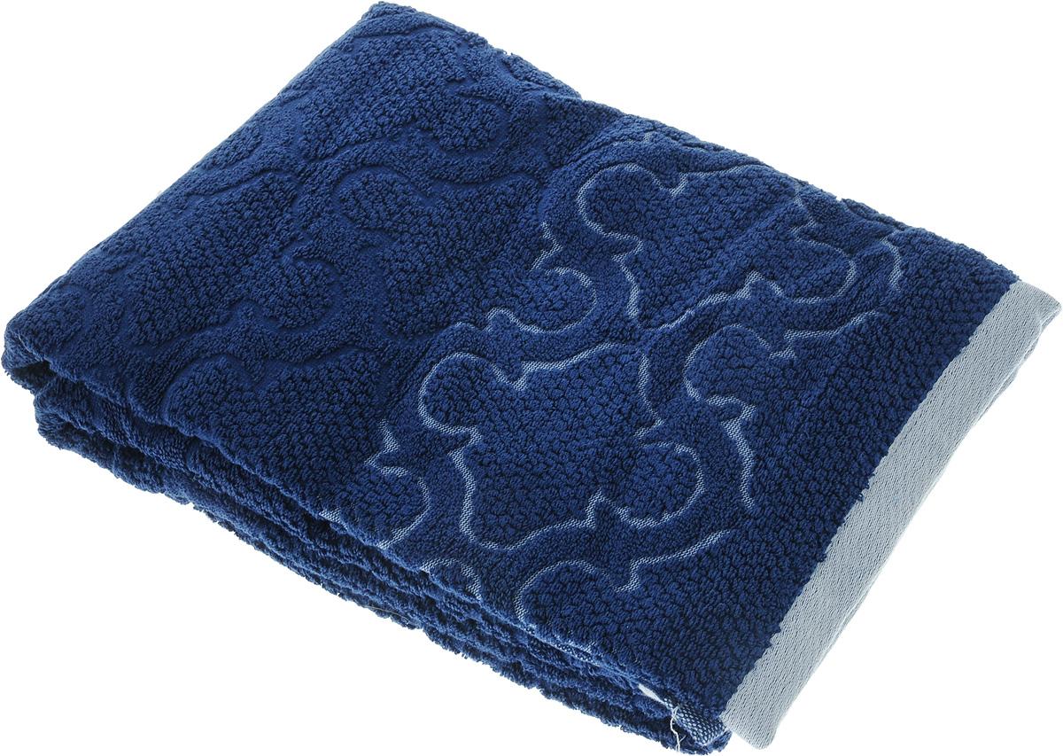 Полотенце махровое Toalla Лагуна, цвет: темно-синий, 70 x 140 смS03301004Полотенце махровое Toalla Лагуна выполнено из 100% натурального египетского хлопка. Изделие оформлено изысканным рельефным орнаментом. Ткань полотенца обладает высокой плотностью и мягкостью, отличается высоким качеством и длительным сроком службы. В процессе эксплуатации материал становится только мягче и приятней на ощупь. Египетский хлопок не содержит линта (хлопковый пух), поэтому на ткани не образуются катышки даже после многократных стирок и длительного использования. Сверхдлинные волокна придают ткани характерный красивый блеск. Полотенце отлично впитывает влагу и быстро сохнет. Такое полотенце красиво дополнит интерьер ванной комнаты и станет практичным приобретением.