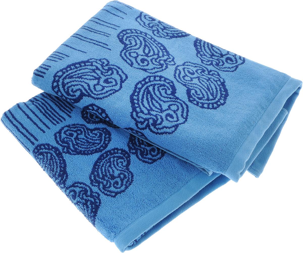 Набор махровых полотенец Toalla Аква, цвет: синий, темно-синий, 2 шт90007261Набор Toalla Аква состоит из 2 прямоугольных махровых полотенец, выполненных из 100% хлопка. Ткань полотенец обладает высокой плотностью и мягкостью, отличается высоким качеством и длительным сроком службы. В процессе эксплуатации материал становится только мягче и приятней на ощупь. Египетский хлопок не содержит линта (хлопковый пух), поэтому на ткани не образуются катышки даже после многократных стирок и длительного использования. Сверхдлинные волокна придают ткани характерный красивый блеск. Полотенца отлично впитывают влагу и быстро сохнут. Такой набор красиво дополнит интерьер ванной комнаты и станет практичным приобретением. Полотенца оформлены изысканными узорами и принтом в полоску.