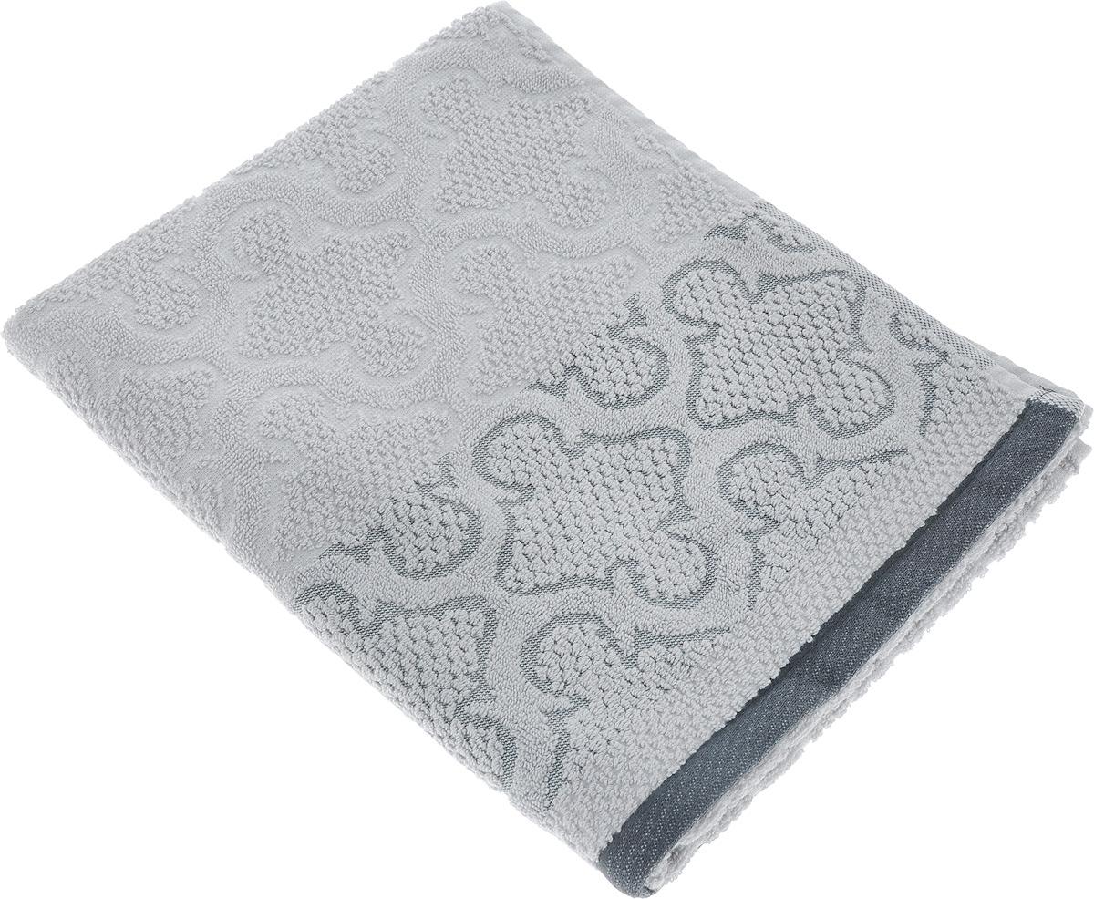 Полотенце махровое Toalla Лагуна, цвет: серый, 50 x 90 см9217131Полотенце махровое Toalla Лагуна выполнено из 100% натурального египетского хлопка. Изделие оформлено изысканным рельефным орнаментом. Ткань полотенца обладает высокой плотностью и мягкостью, отличается высоким качеством и длительным сроком службы. В процессе эксплуатации материал становится только мягче и приятнее на ощупь. Египетский хлопок не содержит линта (хлопковый пух), поэтому на ткани не образуются катышки даже после многократных стирок и длительного использования. Сверхдлинные волокна придают ткани характерный красивый блеск. Полотенце отлично впитывает влагу и быстро сохнет. Такое полотенце красиво дополнит интерьер ванной комнаты и станет практичным приобретением.