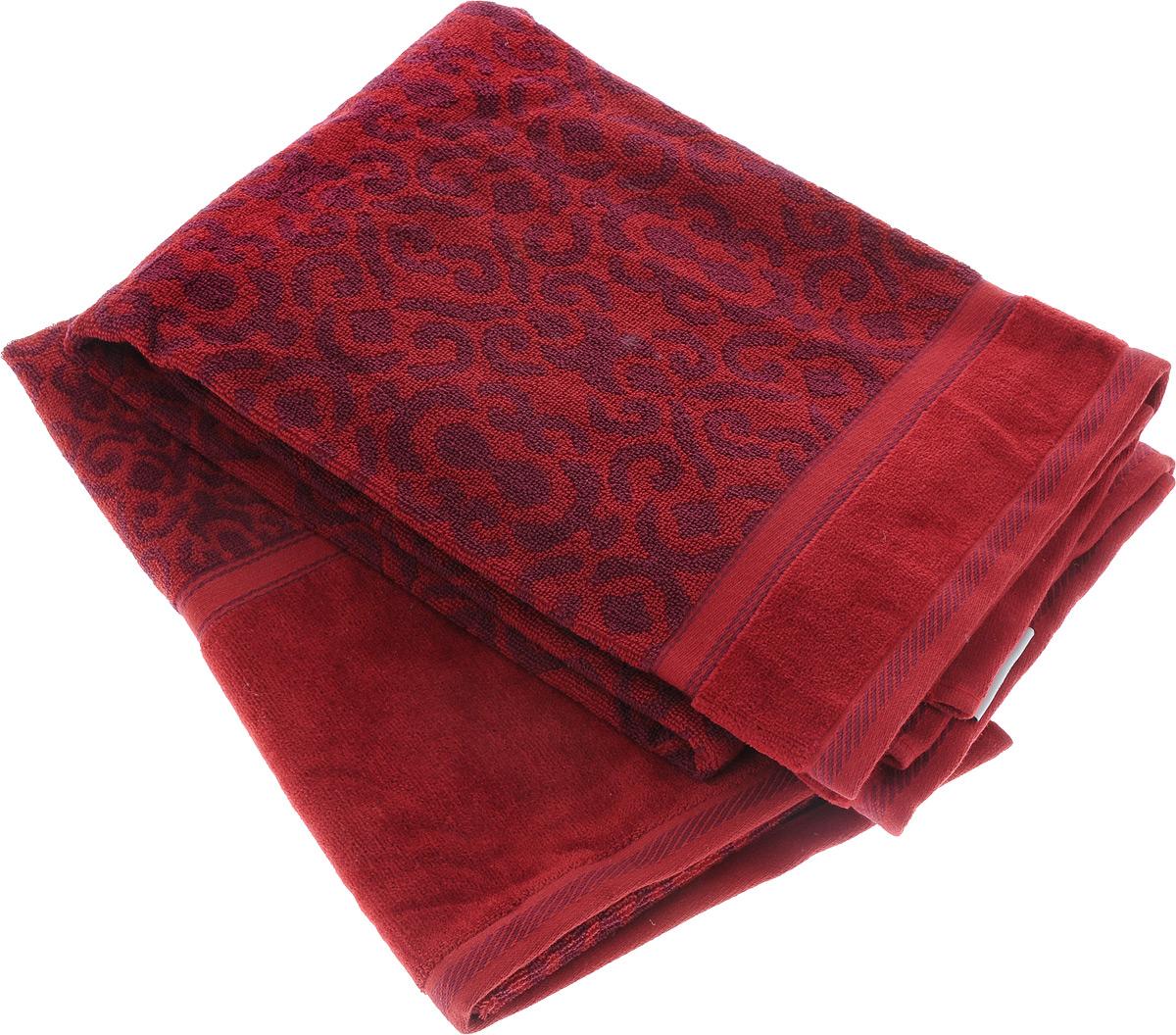 Набор махровых полотенец Toalla Флора, цвет: бордовый, фиолетовый, 2 шт68/5/2Набор Toalla Флора состоит из 2 прямоугольных махровых полотенец, выполненных из 100% хлопка. Ткань полотенец обладает высокой плотностью и мягкостью, отличается высоким качеством и длительным сроком службы. В процессе эксплуатации материал становится только мягче и приятней на ощупь. Египетский хлопок не содержит линта (хлопковый пух), поэтому на ткани не образуются катышки даже после многократных стирок и длительного использования. Сверхдлинные волокна придают ткани характерный красивый блеск. Полотенца отлично впитывают влагу и быстро сохнут. Такой набор красиво дополнит интерьер ванной комнаты и станет практичным приобретением. Полотенца оформлены изысканными узорами.