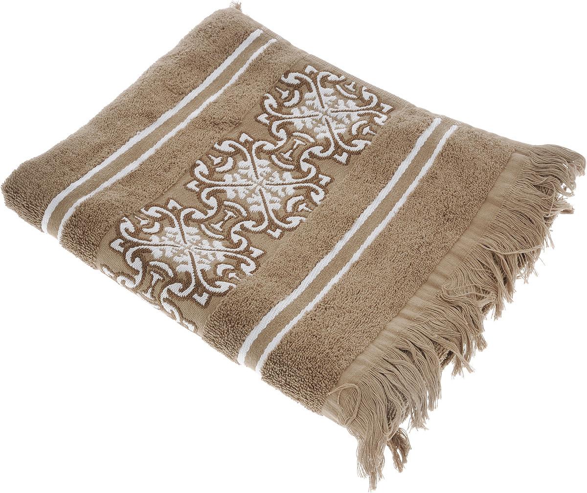 Полотенце махровое Toalla Норрис, цвет: светло-коричневый, 50 x 90 см9271741Полотенце махровое Toalla Норрис выполнено из 100% хлопка. Ткань полотенца обладает высокой плотностью и мягкостью, отличается высоким качеством и длительным сроком службы. В процессе эксплуатации материал становится только мягче и приятней на ощупь. Египетский хлопок не содержит линта (хлопковый пух), поэтому на ткани не образуются катышки даже после многократных стирок и длительного использования. Сверхдлинные волокна придают ткани характерный красивый блеск. Полотенце отлично впитывает влагу и быстро сохнет. Такое полотенце красиво дополнит интерьер ванной комнаты и станет практичным приобретением. Полотенце оформлено бордюром с изящным вышитым орнаментом и дополнено бахромой.