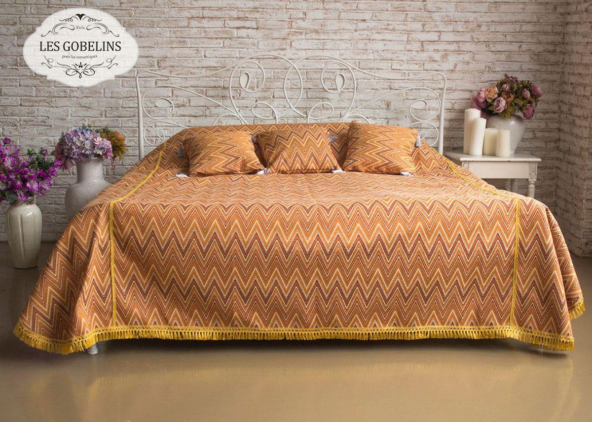 Покрывало на кровать Les Gobelins Zigzag, цвет: коричневый, 240 х 220 смlns186143Покрывало на кровать Les Gobelins Zigzag с ярким геометрическим рисунком привлечет к себе внимание и органично впишется в интерьер комнаты. Изделие изготовлено из высококачественной ткани гобелен и оформлено бахромой и кисточками. Необычайная красота сочетается в этом покрывале с высокой прочностью и долговечностью, а свойство гобелена по-разному проявлять себя в зависимости от освещения помещения позволяет открывать все новые и новые детали, которые, как казалось, раньше скрывал гобелен.Красочное и приятное на ощупь покрывало сделает интерьер спальни, детской или гостиной уютнее и своеобразнее. Состав материала: 52% хлопок, 48% полиэстер.