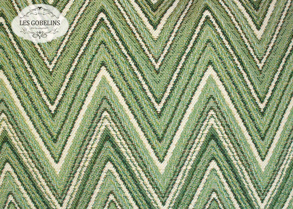 Покрывало на диван Les Gobelins Zigzag, цвет: зеленый, 160 х 200 см12245Покрывало на диван Les Gobelins Zigzag с ярким геометрическим рисунком привлечет к себе внимание и органично впишется в интерьер комнаты. Изделие изготовлено из высококачественной ткани гобелен и оформлено бахромой и кисточками. Необычайная красота сочетается в этом покрывале с высокой прочностью и долговечностью, а свойство гобелена по-разному проявлять себя в зависимости от освещения помещения позволяет открывать все новые и новые детали, которые, как казалось, раньше скрывал гобелен.Красочное и приятное на ощупь покрывало сделает интерьер спальни, детской или гостиной уютнее и своеобразнее. Состав материала: 52% хлопок, 48% полиэстер.