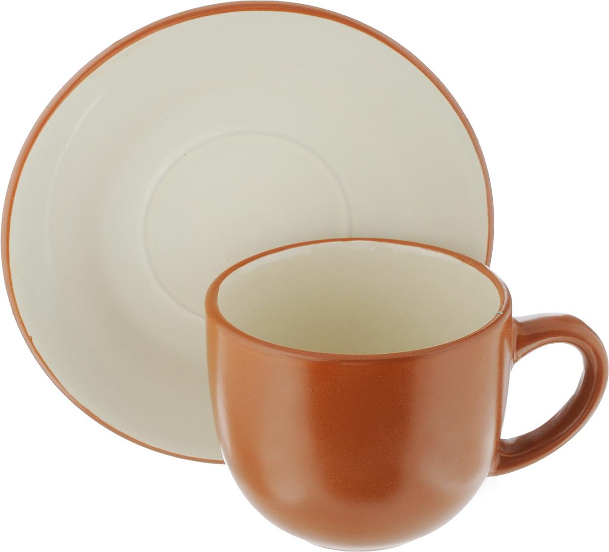 Чайная пара Ломоносовская керамика, 2 предмета. 1ЧП-220ТК1ЧП-220ТКЧайная пара Ломоносовская керамика состоит из чашки и блюдца. Изделия, выполненные из высококачественной глины с глазурованным покрытием, имеют элегантный дизайн. Такая чайная пара прекрасно подойдет как для повседневного использования, так и для праздников. Объем чашки: 200 мл. Диаметр чашки (по верхнему краю): 8,5 см. Высота чашки: 7 см. Диаметр блюдца: 14,5 см. Высота блюдца: 1,7 см.