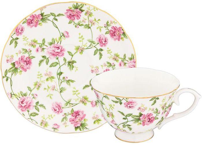 Чайная пара Elan Gallery Плетистая роза, 2 предмета740279Шикарная чайная пара на 1 персону в нежных тонах станет памятным подарком. В комплекте 1 чашка на ножке объемом 250 мл, 1 блюдце. Изделие имеет прозрачную подарочную упаковку с бантиком, поэтому станет желанным подарком для Ваших близких, коллег и друзей!
