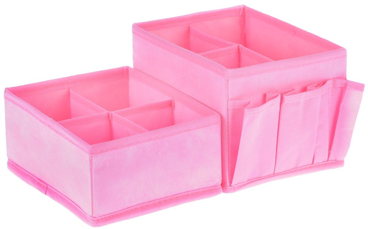 Набор органайзеров для косметики Все на местах Minimalistic, цвет: розовый, 2 предмета531-401Набор состоит из двух органайзеров для хранения косметики и аксессуаров. Изделия выполнены из высококачественного нетканого материала (спанбонда), который обеспечивает естественную вентиляцию, позволяя воздуху проникать внутрь, но не пропускает пыль. Вставки из ПВХ хорошо держат форму. Мягкие перегородки образуют секции для хранения разнообразной косметики. Наружные кармашки позволяют удобно хранить мелкие аксессуары. Изделия отличаются мобильностью: легко раскладываются и складываются. Набор органайзеров для косметики и аксессуаров поможет привести элементы женского туалета в порядок. Оригинальный дизайн придется по вкусу ценительницам эстетичного хранения. Размер органайзеров: 15 см х 15 см х 14 см; 15 см х 15 см х 7 см.
