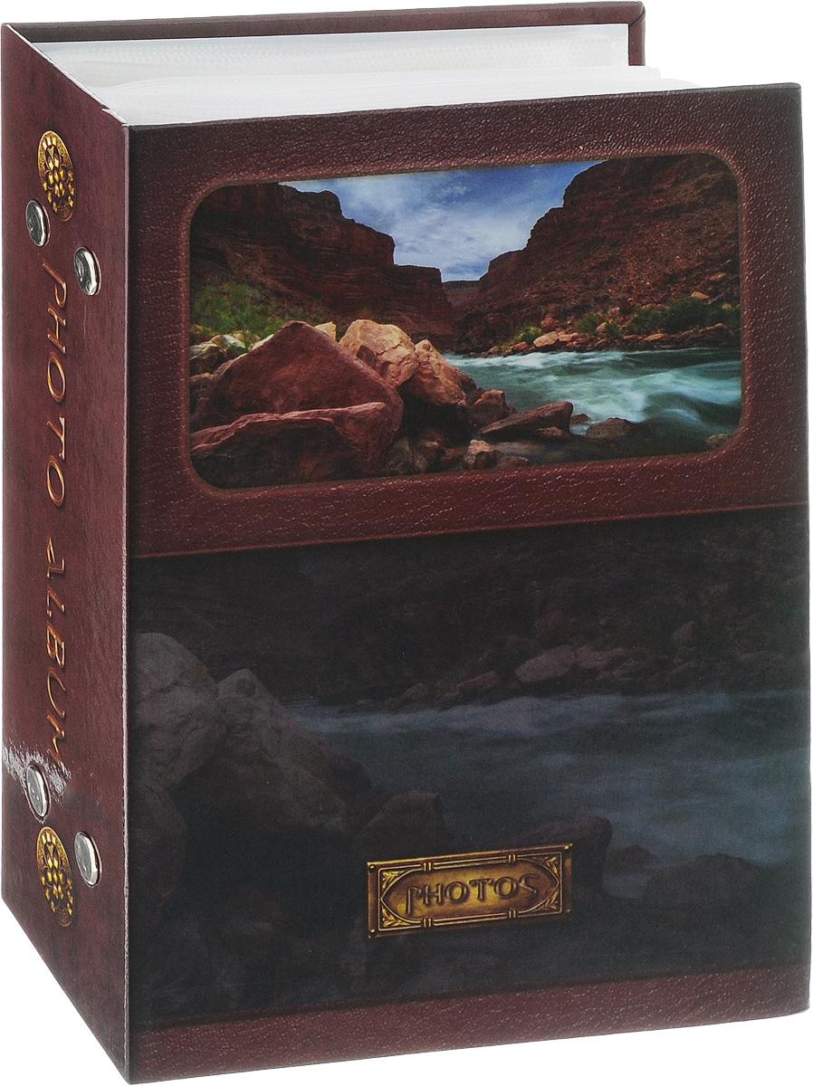 Фотоальбом Pioneer Landscape, 100 фотографий, цвет: коричневый, 10 x 15 смUP210DFФотоальбом Pioneer Landscape поможет красиво оформить ваши самые интересные фотографии. Обложка, выполненная из толстого ламинированного картона, оформлена ярким изображением. Внутри содержится блок из 50 белых листов с фиксаторами-окошками из полипропилена. Альбом рассчитан на 100 фотографий формата 10 х 15 см (по 1 фотографии на странице). Переплет - книжный. Нам всегда так приятно вспоминать о самых счастливых моментах жизни, запечатленных на фотографиях. Поэтому фотоальбом является универсальным подарком к любому празднику.Количество листов: 50.