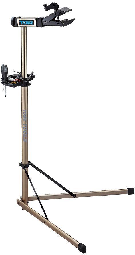 Стойка механическая To Be, на 2-х ножках. 2050АС.050030Стойки для велосипеда B196095 Регулируемый зажим,вращающийся на 360 градусов позволяет распологать велосипед под любым углом и делает вашу работу легче Особенности:Вес 5,4кг;Захват рам от 1 до 2,5;Очень легко открыть зажим для хранения или технического обслуживания;Лоток для инструментов в комплекте