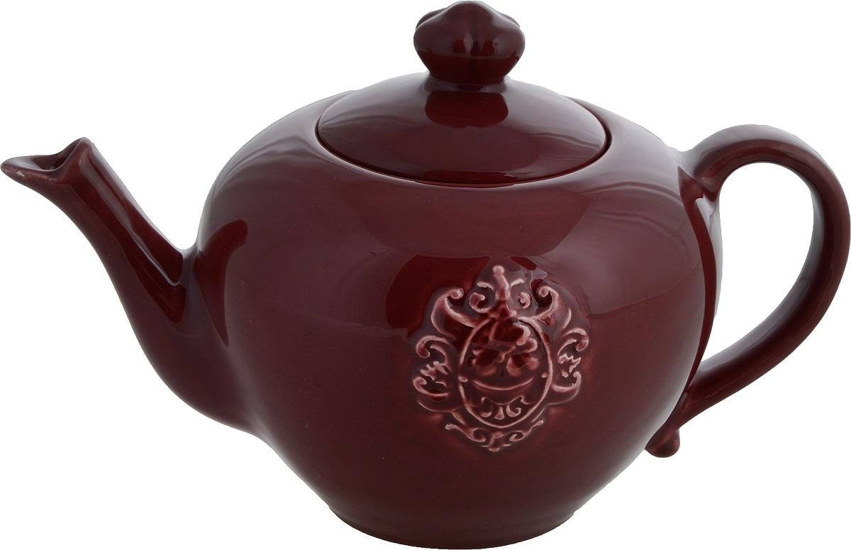 Чайник заварочный Nuova Cer Аральдо, цвет: бордовый, 1 лNC8304-RNO-AL_бордовыйЗаварочный чайник Nuova Cer Аральдо изготовлен из высококачественной керамики. Глазурованное покрытие обеспечивает легкую очистку. Изделие прекрасно подходит для заваривания вкусного и ароматного чая, а также травяных настоев. Отверстия в основании носика препятствуют попаданию чаинок в чашку. Оригинальный дизайн сделает чайник настоящим украшением стола. Он удобен в использовании и понравится каждому. Не рекомендуется мыть в посудомоечной машине и использовать в микроволновой печи. Диаметр чайника (по верхнему краю): 8,5 см. Высота чайника (без учета крышки): 12 см. Высота чайника (с учетом крышки): 16 см. Ширина чайника (с учетом ручки и носика): 25 см.