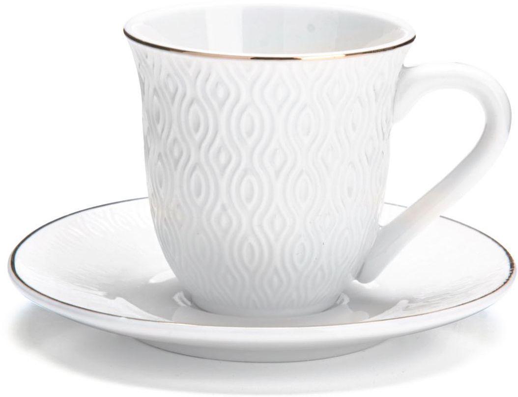 Кофейный сервиз Loraine, 90 мл, подарочная упаковка. 2682126821Кофейный набор на 6 персон Loraine выполнен из высококачественного костяного фарфора - материала безопасного для здоровья и надолго сохраняющего тепло напитка.Несмотря на свою внешнюю хрупкость, каждый из предметов набора обладает высокой прочностью и надежностью. Элегантный классический дизайн с тонкой золотой каймой делает этот кофейный набор прекрасным украшением любого стола. Набор аккуратно упакован в подарочную упаковку, поэтому его можно преподнести в качестве оригинального и практичного подарка для своих родных и самых близких. В наборе: 6 кофейных чашек, 6 блюдец. Подходит для мытья в посудомоечной машине.