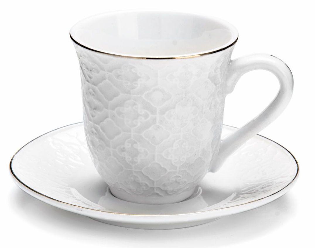 Кофейный сервиз Loraine, 90 мл, подарочная упаковка. 2682226822Кофейный набор на 6 персон Loraine выполнен из высококачественного костяного фарфора - материала безопасного для здоровья и надолго сохраняющего тепло напитка.Несмотря на свою внешнюю хрупкость, каждый из предметов набора обладает высокой прочностью и надежностью. Элегантный классический дизайн с тонкой золотой каймой делает этот кофейный набор прекрасным украшением любого стола. Набор аккуратно упакован в подарочную упаковку, поэтому его можно преподнести в качестве оригинального и практичного подарка для своих родных и самых близких. В наборе: 6 кофейных чашек, 6 блюдец. Подходит для мытья в посудомоечной машине.
