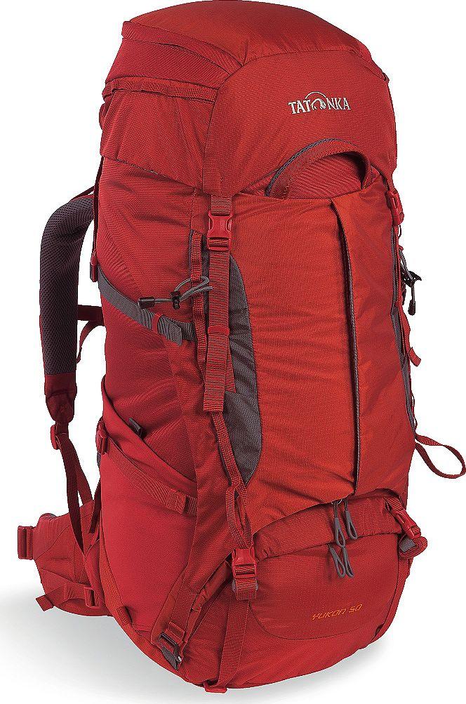 Рюкзак туристический Tatonka Yukon, цвет: красный, 50+10 л1352.254Классический туристический рюкзак - идеальный выбор для разнообразных походов. Рюкзак оптимизирован для грузов среднего веса (до 20-25 кг), и представляет собой идеальный баланс легкости, прочности и комфорта. Система V2 совершенствовалась с годами, и всегда получала самые лучшие оценки как от профессионалов, так и от новичков. В обновленном рюкзаке отлично сочетаются и обновленная система переноски, и более тонкие, но прочные материалы, и максимальный комфорт при переноске рюкзака. Yukon оснащен 3D-входом в основное отделение, что делает более эффективным и быстрым процесс упаковки рюкзака. Дно рюкзака выполнено из прочного непромокаемого материала Cordura. Преимущества и особенности Система переноски V2 Разделенные верхнее и нижнее отделения Фиксаторы для треккинговых палок или ледорубов Полностью адаптивная система настройки спины Компрессионные стропы по бокам Прочные ручки в передней и задней частях рюкзака Прочные молнии размера 10 3D-вход в...