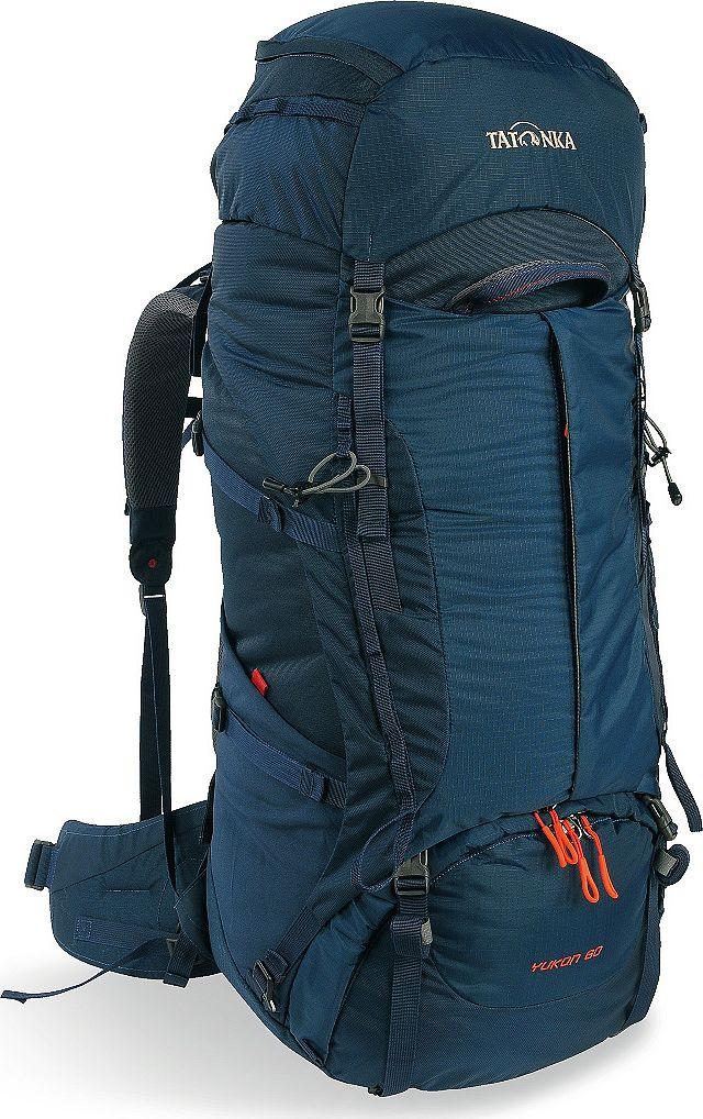Рюкзак туристический Tatonka Yukon, цвет: темно-синий, 60+10 л61093Классический туристический рюкзак - идеальный выбор для разнообразных походов. Рюкзак оптимизирован для грузов среднего веса (до 20-25 кг), и представляет собой идеальный баланс легкости, прочности и комфорта. Система V2 совершенствовалась с годами, и всегда получала самые лучшие оценки как от профессионалов, так и от новичков. В обновленном рюкзаке отлично сочетаются и обновленная система переноски, и более тонкие, но прочные материалы, и максимальный комфорт при переноске рюкзака. Yukon оснащен 3D-входом в основное отделение, что делает более эффективным и быстрым процесс упаковки рюкзака. Дно рюкзака выполнено из прочного непромокаемого материала Cordura.Преимущества и особенностиСистема переноски V2Разделенные верхнее и нижнее отделенияФиксаторы для треккинговых палок или ледорубовПолностью адаптивная система настройки спиныКомпрессионные стропы по бокамПрочные ручки в передней и задней частях рюкзакаПрочные молнии размера 103D-вход в основное отделениеРегулируемая по высоте крышка рюкзакаКарман в крышкеВ коплекте - чехол от дождяВыход для питьевой системыДно из материала CorduraБоковые эластичные карманыДополнительные петли в центральной части рюкзакаОтделение для аптечки (пустое)Передний карман на молнии