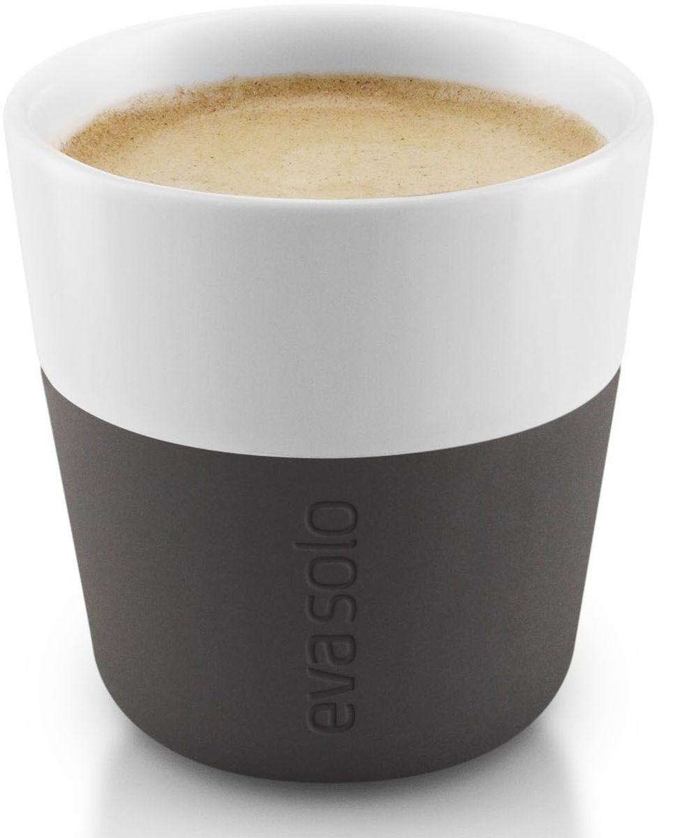 Чашки для эспрессо Eva Solo, 80 мл, 2 шт., цвет: черный501001Чашка для эспрессо от Eva Solo рассчитана на 80 мл - классическое количество эспрессо, а также стандарт для большинства кофе-машин. Чашка сделана из фарфора и имеет специальный силиконовый чехол, чтобы ее можно было держать в руках, не рискуя обжечь пальцы. Чехол легко снимается, и чашку можно мыть в посудомоечной машине. Умные и красивые предметы посуды от Eva Solo будут украшением любой кухни!