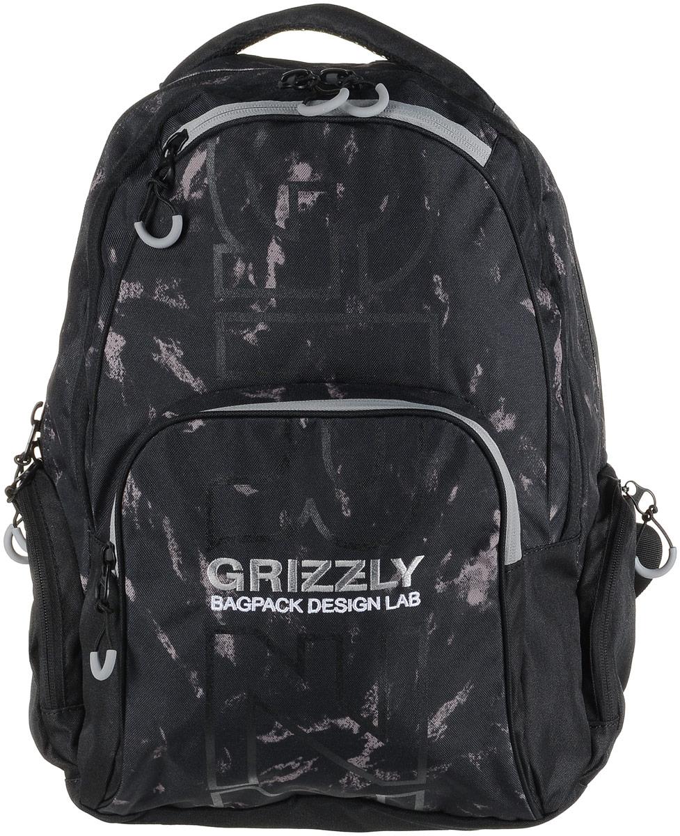Рюкзак мужской Grizzly, цвет: черный, серый. RU-709-2/2SVCB-RT6-E150Рюкзак Grizzly - это красивый и удобный рюкзак, который подойдет всем, кто хочет разнообразить свои будни. Рюкзак выполнен из плотного материала с оригинальным графическим принтом. Рюкзак содержит два вместительных отделения, каждое из которых закрывается на молнию. Внутри первого отделения имеется открытый накладной карман, на стенке которого расположился врезной карман на молнии. Второе отделение не содержит дополнительных карманов. Снаружи, по бокам изделия, расположены два кармана на застежках-молниях. Лицевая сторона дополнена двумя карманами на застежках-молниях. В нижнем кармане расположены четыре открытых накладных кармашка.Рюкзак оснащен мягкой укрепленной ручкой для переноски, петлей для подвешивания и двумя практичными лямками регулируемой длины.Практичный рюкзак станет незаменимым аксессуаром и вместит в себя все необходимое.