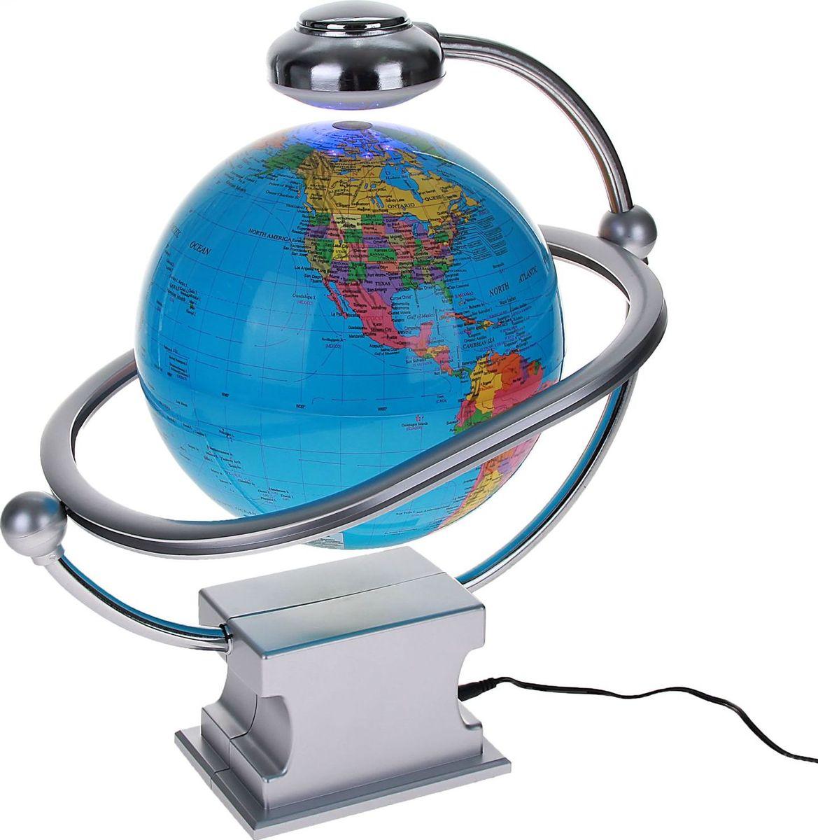Глобус Политическая карта на английском языке цвет синий диаметр 20 см цвет синийFS-00897Глобус сувенирный на магнитном поле, d=20 см, h=36 см, с подсветкой, политическая карта, английский язык, 220 В, синий — это украшение рабочего места и кладезь полезной информации о Земле. С его помощью вы увидите полет планеты в миниатюре. Этот гаджет имеет еще несколько названий: антигравитационный, левитирующий или левитрон. Раскроем секрет этого чуда. В базу встроен электромагнит, а в шар — магнит с противоположным зарядом. В результате сфера зависает в воздухе и вращается вокруг своей оси. Особенности антигравитационного глобуса Поворачивайте шар, пока он парит в воздухе. Это снимает нервное напряжение и помогает отвлечься от рутинной работы. Оригинальная задумка станет вашим источником вдохновения во время умственного процесса.