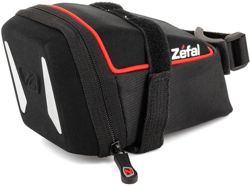 Велосумка под седло Zefal Iron Pack L-DS, 13 х 6 х 6 см7031ZEFAL Iron Pack L-DS незаметно размещается под седлом, надёжно закрепляясь за рамки седла и подседельный штырь ремешками с двойной липучкой велкро. Износостойкий материал сумки 840 D2 EVA и молнии с влагозащитой не пропускают внутрь воду и пыль, вы можете смело перевозить в ней телефон, ключи и документы. Для Вашей большей безопасности, на сумку нанесены светоотражающие элементы. ZEFAL – старейший французский производитель велосипедных аксессуаров премиального качества, основанный в 1880 году, является номером один на французском рынке велосипедных аксессуаров. • Крепление за рамки седла и подседельный штырь • Вес 110 г. • Размер 160 х 85 х 90 мм. • Объём 0,8 л. • Материал сумки 840 D2 EVA • Молнии с влагозащитой • Светоотражающие элементы