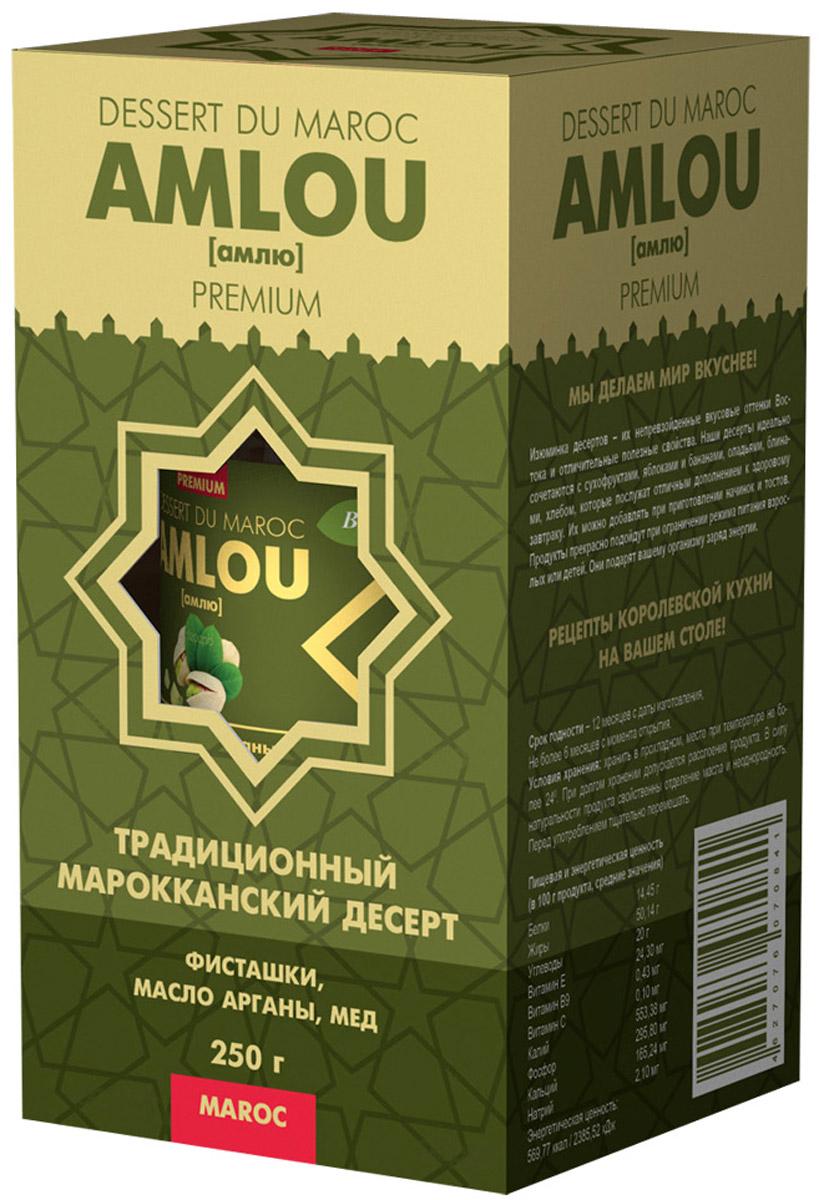 """""""AMLOU"""" (амлю) Традиционный марокканский десерт из масла арганы, орехов и цветочного меда. Предназначен для здорового, сбалансированного и полноценного питания. Кардинальное отличие амлю от других десертов в том, что этот продукт содержит ценное масло арганы, являющегося источником витамина Е и полиненасыщенных жирных кислот Омега-6, Омега-9. Оно полностью усваивается организмом человека и способствует замедлению процесса старения клеток. МАСЛО АРГАНЫ Масло арганы широко известно в мире, и его полезные свойства успешно применяют в медицине, кулинарии. Пищевое масло арганы получают прессованием семян арганового дерева. При регулярном употреблении в пищу аргановое масло нормализует показатели артериального давления и сердцебиения. Всего пара столовых ложек в течение дня препятствует развитию инфекций бактериальной и грибковой природы. Следует также отметить, что масло арганы при регулярном употреблении в несколько раз снижает вероятность возникновения и развития..."""