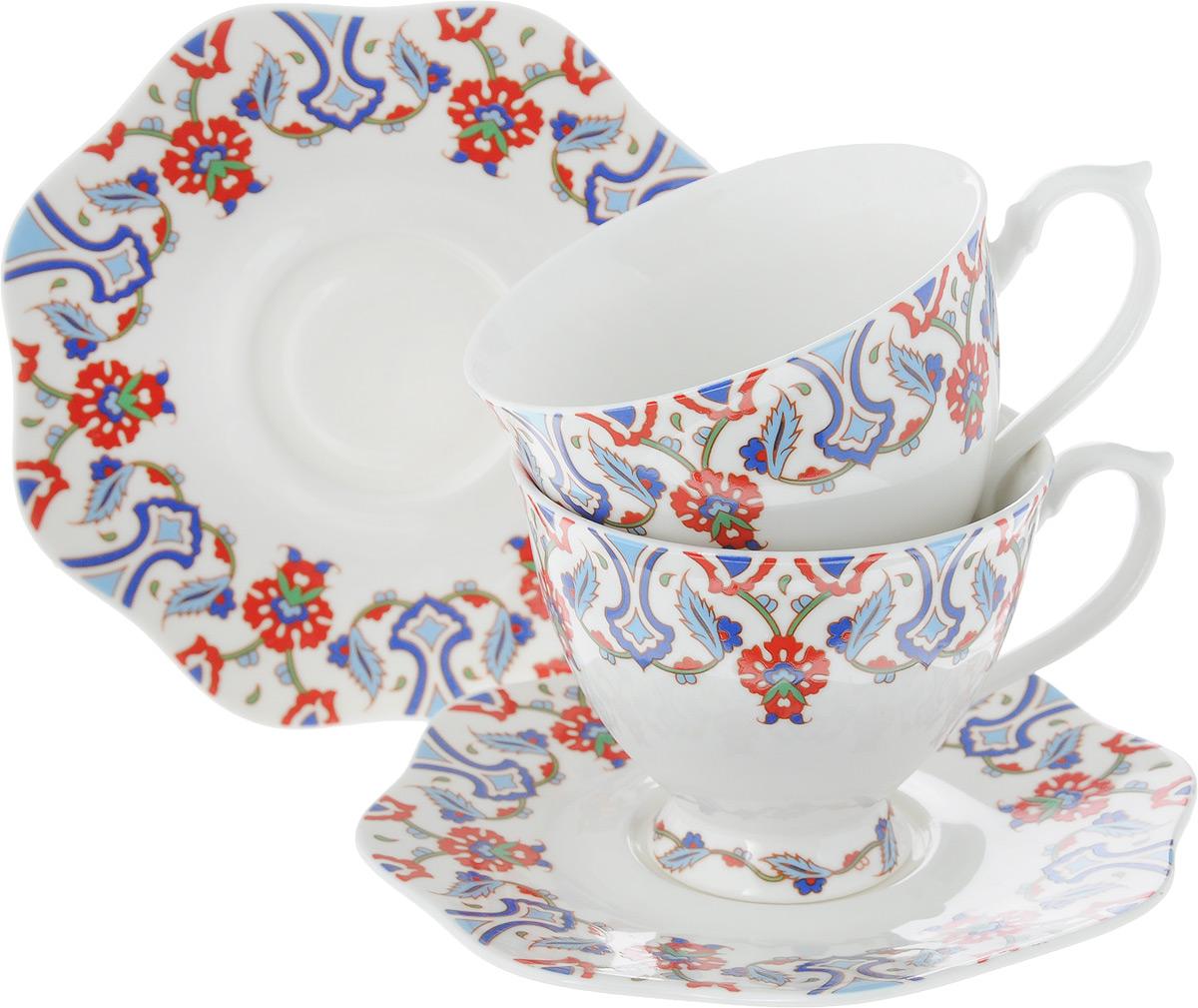 Набор чайный Loraine, 4 предмета. 26618115610Чайный набор Loraine на 2 персоны выполнен из высококачественного костяного фарфора - материала, безопасного для здоровья и надолго сохраняющего тепло напитка. В наборе 2 чашки и 2 блюдца. Несмотря на свою внешнюю хрупкость, каждый из предметов набора обладает высокой прочностью и надежностью. Изделия дополнены ярким красивым узором. Оригинальный дизайн сделает этот набор изысканным украшением любого стола. Набор упакован в подарочную коробку в форме сердца, поэтому его можно преподнести в качестве оригинального и практичного подарка для родных и близких. Объем чашки: 180 мл. Диаметр чашки (по верхнему краю): 8 см. Высота чашки: 7 см. Диаметр блюдца: 14 см.