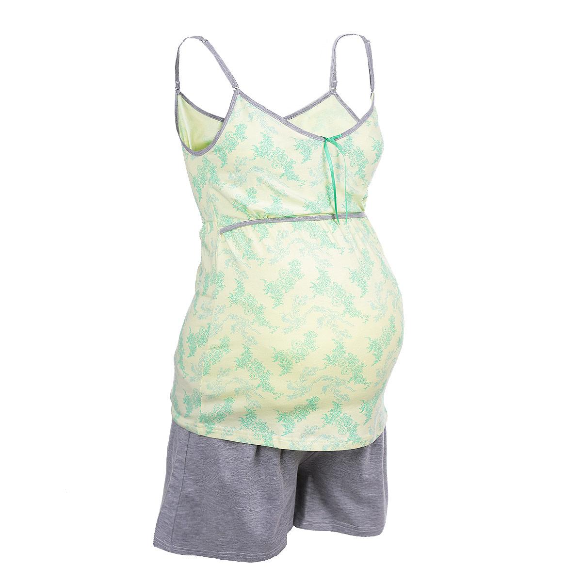 Пижама24142Удобная и стильная пижама для беременных и кормящих мам Мамин Дом, изготовленная из эластичного хлопка, подчеркнет ваше очарование в этот прекрасный период вашей жизни. Топ на тонких бретелях оформлен очаровательным цветочным принтом и украшен декоративным бантиком, а штанишки выполнены в контрастных цветах. Бретельки регулируются по длине. Благодаря свободному крою, она подарит вам комфорт на любом сроке беременности, и после родов. Секрет для кормления в виде двойного топа обеспечивает удобный и быстрый доступ к груди, и хорошую поддержку. Широкий и эластичный пояс великолепно садится по бедрам и легко приспосабливается к растущему животику. Пижама сочетается с кардиганом арт. 25307 Skylight. Такая пижама сделает отдых будущей мамы комфортным. Одежда, изготовленная из хлопка, приятна к телу, сохраняет тепло в холодное время года и дарит прохладу в теплое, позволяет коже дышать.
