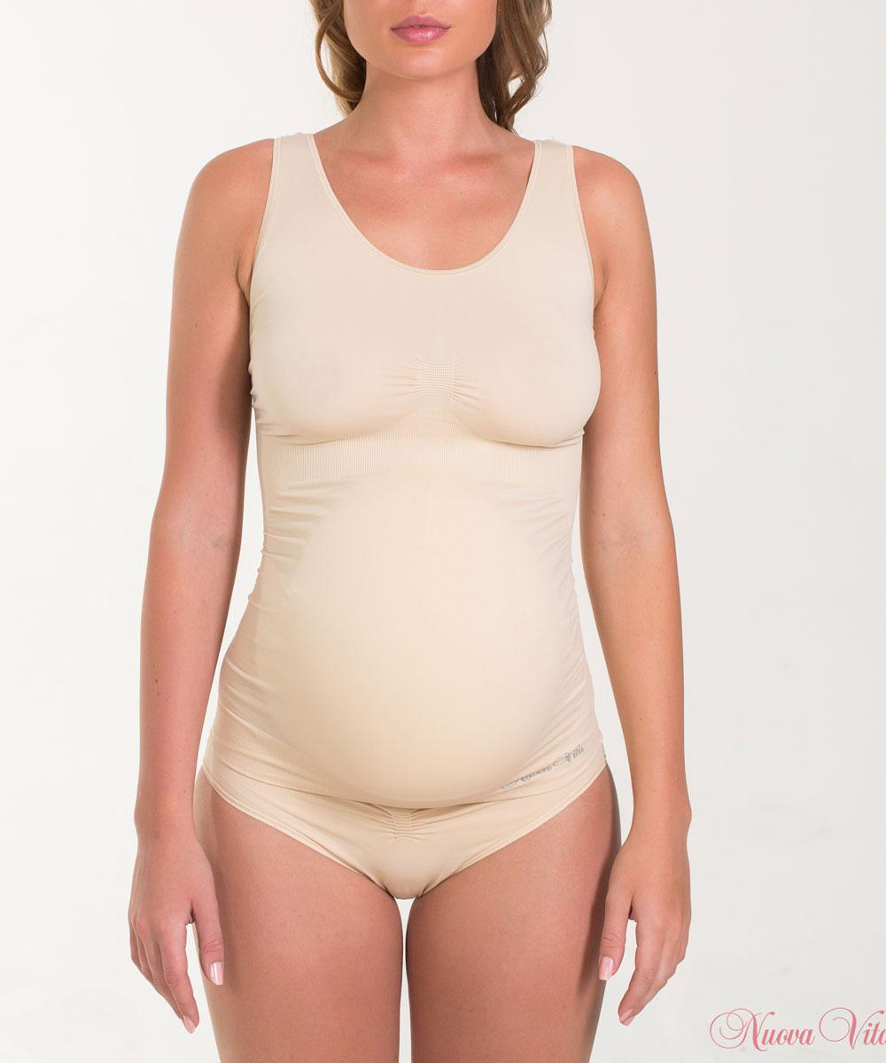 Майка14879Бесшовная майка для беременных Nuova Vita, изготовленная из мягкой микрофибры, идеально подходит для любого периода беременности. Отсутствие швов обеспечивает комфорт даже для чувствительной кожи и позволяет носить ее под облегающей одеждой. Шелковисто-мягкая нейлоновая ткань обеспечивает комфорт в течении всего дня. Это бесшовное белье предназначено, чтобы приспособиться к вашему телу и обеспечивает максимальный комфорт. Майка с антибактериальной защитой и влагоабсорбирующая.