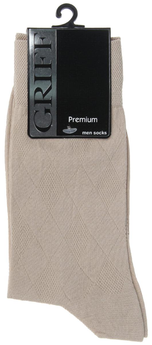 НоскиE5Мужские носки Griff Premium изготовлены из мерсеризованого хлопка с добавлением полиамидных волокон, которые обеспечивают великолепную посадку. Носки с орнаментом отличаются элегантным внешним видом. Удобная широкая резинка идеально облегает ногу и не пережимает сосуды, усиленные пятка и мысок повышают износоустойчивость носка, а удлиненный паголенок придает более эстетичный вид.