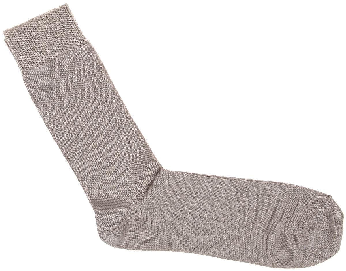 НоскиMS024Мужские носки Uomo Fiero превосходного качества, изготовленные из высококачественного комбинированного материала, очень мягкие и приятные на ощупь, позволяют коже дышать. Эластичная резинка плотно облегает ногу, не сдавливая ее, обеспечивая комфорт и удобство. Носки обладают повышенной прочностью, не подвержены усадке. Модель с удлиненным паголенком. Идеальное сочетание практичности, комфорта и элегантности!