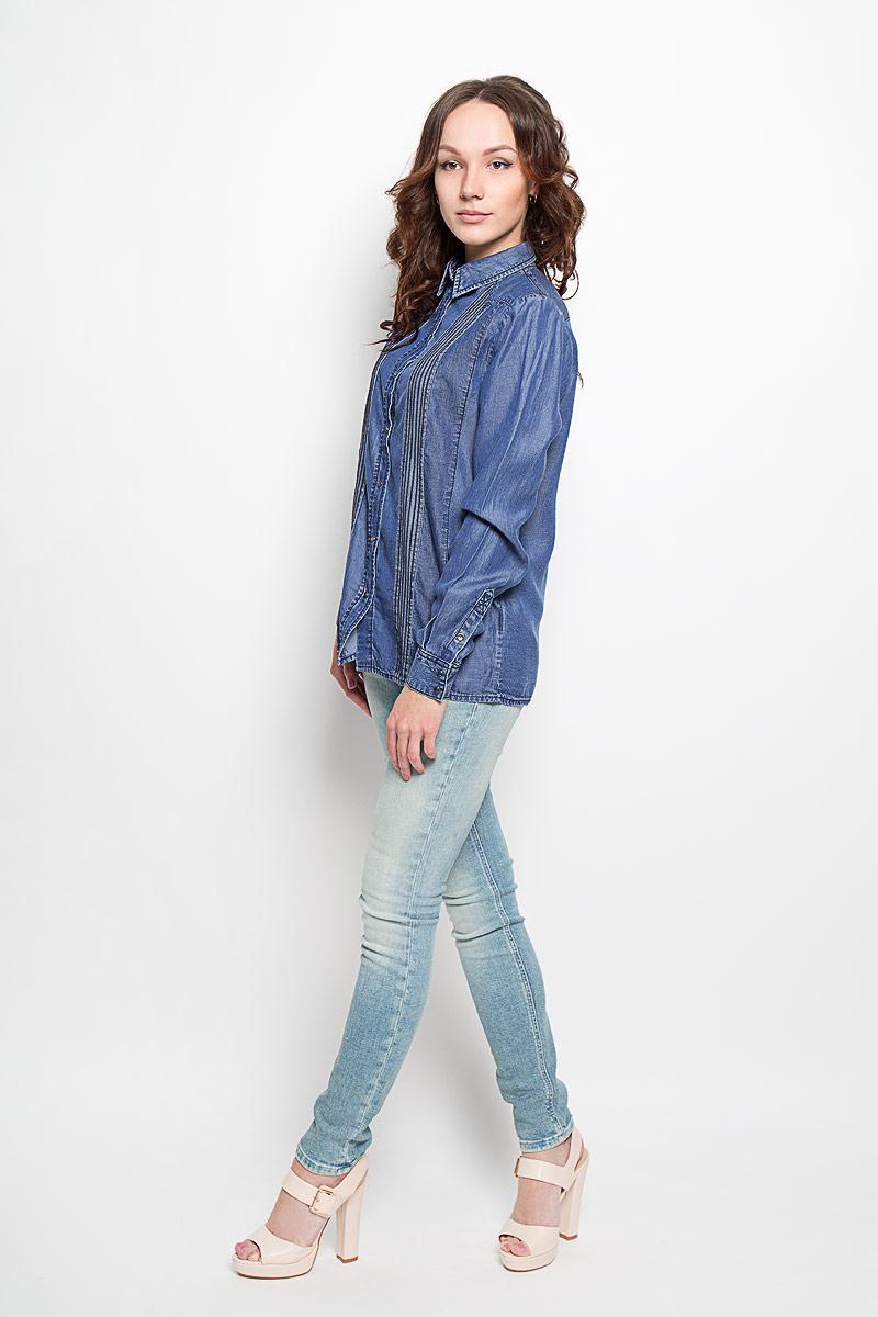 Рубашка00SNP8-0KAKP_01Симпатичная женская рубашка Diesel, выполненная из 100% лиоцелла, обладает высокой теплопроводностью, воздухопроницаемостью и гигроскопичностью, позволяет коже дышать. Модель с длинными рукавами и отложным воротником - идеальный вариант для создания образа в стиле Casual. Рубашка спереди застегивается на кнопки. Манжеты рукавов также застегиваются на кнопку. Спереди модель дополнена оригинальными вставками и прострочкой. Такая модель будет дарить вам комфорт в течение всего дня и послужит замечательным дополнением к вашему гардеробу.