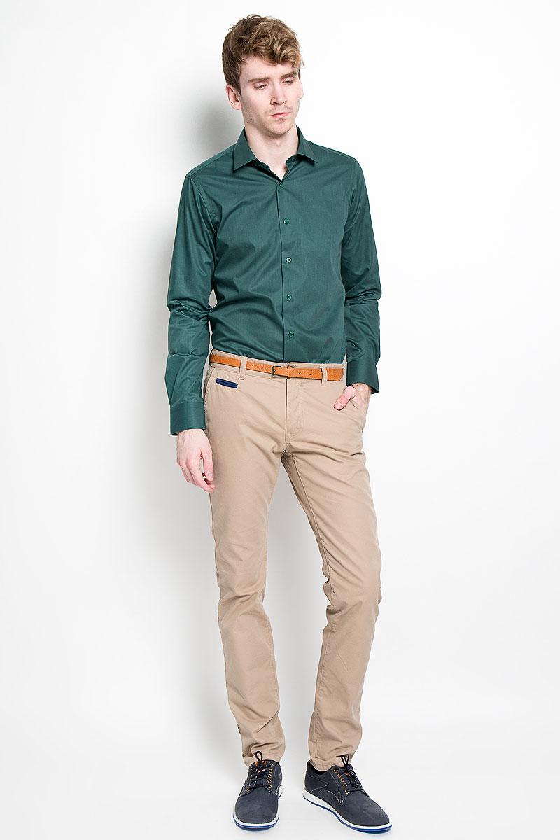 Рубашка мужская KarFlorens, цвет: темно-зеленый. SW 81_04. Размер 41/42 (48/170)SW 81_04Мужская рубашка KarFlorens, изготовленная из высококачественного хлопка с добавлением микрофибры, необычайно мягкая и приятная на ощупь, она не сковывает движения и позволяет коже дышать, обеспечивая комфорт.Модель классического кроя с длинными рукавами и отложным воротником застегивается на пластиковые пуговицы, которые декорированы названием бренда. Манжеты со срезанными уголками и регулировкой ширины также застегиваются на пуговицы. Такая рубашка станет идеальным вариантом для повседневного гардероба. Она порадует настоящих ценителей комфорта и практичности!
