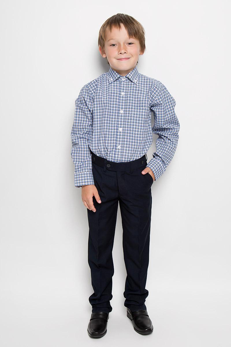 РубашкаTr.151/Gr/12/25Стильная рубашка для мальчика Imperator идеально подойдет вашему юному мужчине. Изготовленная из хлопка с добавлением полиэстера, она мягкая и приятная на ощупь, не сковывает движения и позволяет коже дышать, не раздражает даже самую нежную и чувствительную кожу ребенка, обеспечивая ему наибольший комфорт. Модель классического кроя с длинными рукавами и отложным воротничком застегивается по всей длине на пуговицы. Края воротника пристегиваются к рубашке с помощью пуговиц. На груди располагается накладной карман. Края рукавов дополнены широкими манжетами на пуговицах. Низ изделия немного закруглен к боковым швам. Оформлено изделие принтом в клетку. Такая рубашка будет прекрасно смотреться с брюками и джинсами. Она станет неотъемлемой частью детского гардероба.
