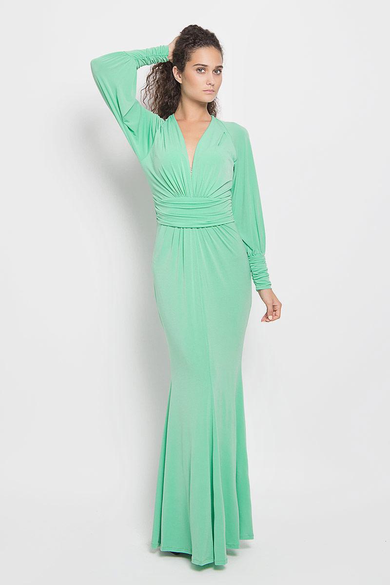 Платье Ruxara, цвет: светло-зеленый. 106100_39. Размер 44106100_39Стильное платье-макси Ruxara, выполненное из высококачественного комбинированного материала, поможет создать отличный современный образ.Модель приталенного силуэта с глубоким V-образным вырезом горловины и длинными рукавами-реглан. Низ рукавов дополнен широкими манжетами, которые собраны на резинку. Изделие по талии оформлено широким поясом со сборкой.Такое платье поможет создать яркий и привлекательный образ, в нем вам будет удобно и комфортно.