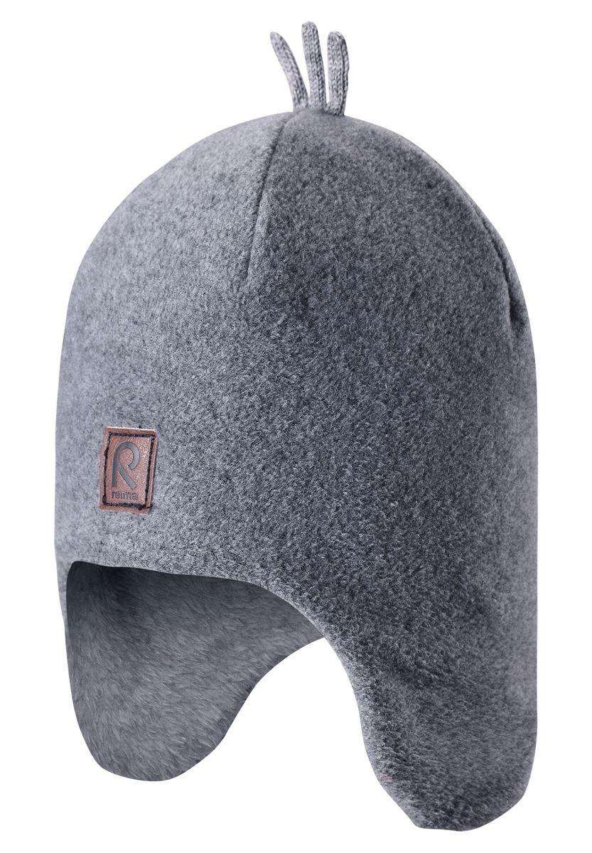 Шапка детская Reima Toppen, цвет: серый. 528452-9400A. Размер 50528452-9400AКрасивая и модная шапка для малышей и детей постарше украшена забавными деталями в зимнем стиле! Она сделана из теплого и мягкого флиса и имеет уютную вязаную подкладку. Ветронепроницаемые вставки в области ушей защищают маленькие ушки от резкого ветра и холодной погоды во время игры в снежки. Стильные и классические цвета оживят любую одежду и легко с ней сочетаются.