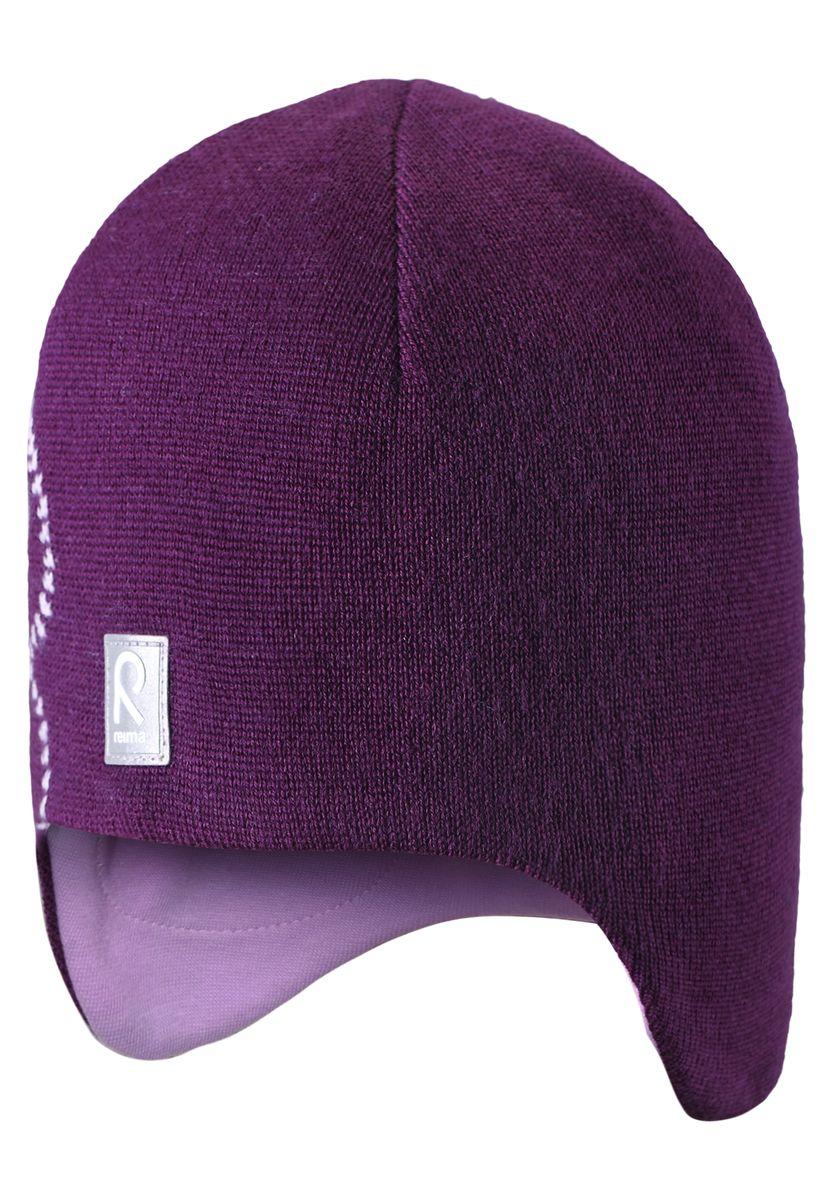 Шапка для девочки Reima Muhkea, цвет: фиолетовый. 528492-4900. Размер 50528492-4900Шерстяная шапка - главный выбор маленьких принцесс для холодных зимних дней! Теплая шерстяная шапка на подкладке из эластичного хлопчатобумажного трикотажа очень удобно носится. Модель защищает ушки и лоб, а ветронепроницаемые вставки в области ушей обеспечивают дополнительную защиту от холодного ветра. Красивый жаккардовый узор добавляет изюминку этому образу. Светоотражающая деталь обеспечивает видимость в темноте.