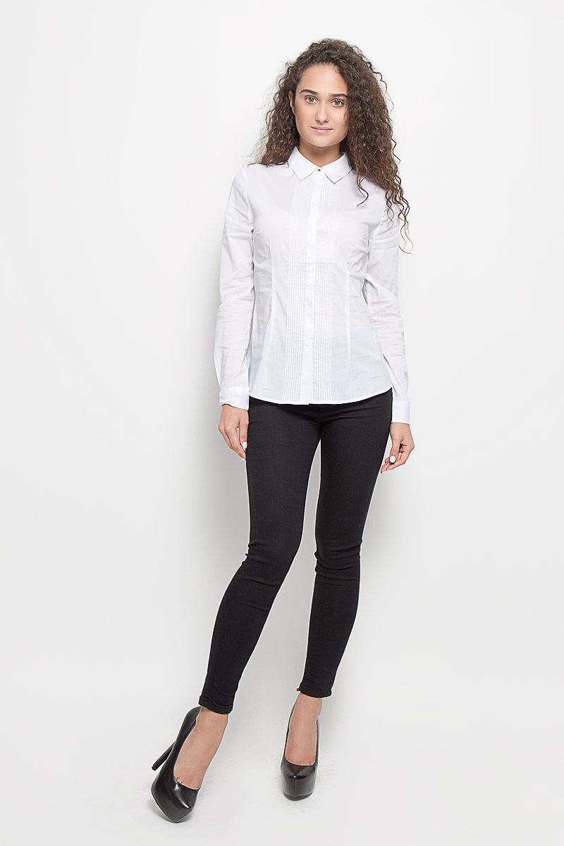 БлузкаB-112/1117-6351Стильная женская блуза Sela, выполненная из эластичного хлопка с добавлением нейлона, подчеркнет ваш уникальный стиль и поможет создать оригинальный женственный образ. Блузка с длинными рукавами и отложным воротником оформлена перманентными складками спереди. Модель застегивается на пуговицы по всей длине спереди, манжеты рукавов также застегиваются на пуговицы. Такая блузка идеально подойдет как для повседневной носки, так и для официальных событий. Эта блузка будет дарить вам комфорт в течение всего дня и послужит замечательным дополнением к вашему гардеробу.