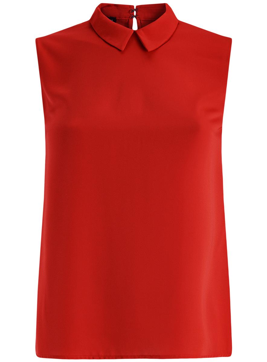 Блузка11411084B/43414/1200NМодная женская блузка oodji Ultra изготовлена из высококачественного полиэстера. Модель с отложным воротником и без рукавов застегивается на два металлических крючка, расположенных на спинке. Спинка оформлена декоративным вырезом.